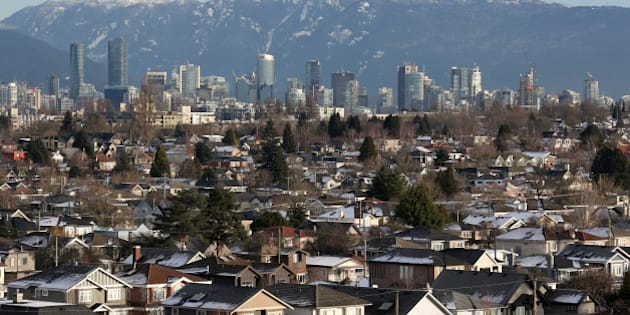 Rooftops of houses in the Kitsilano neighbourhood and the downtown core are seen in Vancouver, British Columbia, Canada January 7, 2017.  REUTERS/Chris Helgren