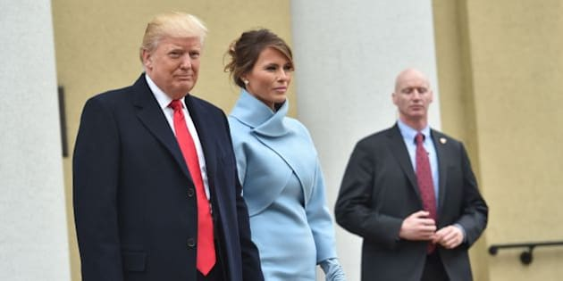US President-elect Donald Trump and his wife Melania leave St. John's Episcopal Church on January 20, 2017, before Trump's inauguration. / AFP / Nicholas Kamm        (Photo credit should read NICHOLAS KAMM/AFP/Getty Images)