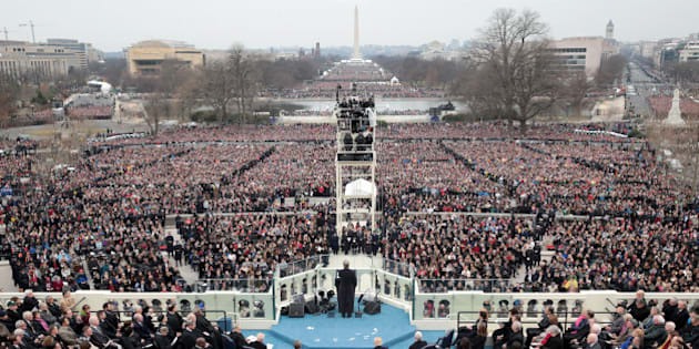 WASHINGTON, DC - JANUARY 20: Spectators watch the inauguration proceedings on the West Front of the U.S. Capitol on January 20, 2017 in Washington, DC. In today's inauguration ceremony Donald J. Trump becomes the 45th president of the United States.  (Photo by Scott Olson/Getty Images)