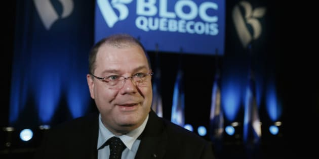 Mario Beaulieu smiles after being named the new leader of the Bloc Quebecois in Montreal, June 14, 2014. According to local media, the Bloc shrank down to four seats in the Commons after the 2011 election from the 49 seats clinched in the 2008 vote. REUTERS/Christinne Muschi (CANADA - Tags: POLITICS HEADSHOT)