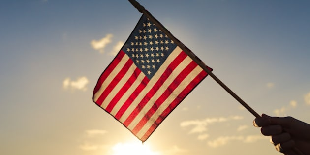 Hand waving american flag.
