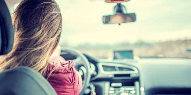 Woman enjoying driving car on her journey