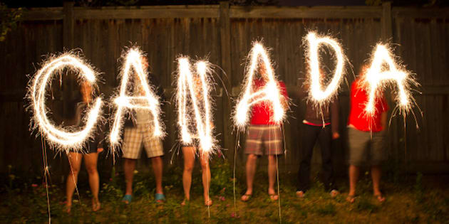 The word Canada in sparklers in time lapse photography as part of Canada Day (July 1) celebration.