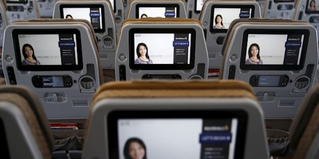 A view of the inflight entertainment screen on the back of economy class seats on the first of 67 new Airbus A350-900 planes delivered to Singapore Airlines at Singapore's Changi Airport March 3, 2016. REUTERS/Edgar Su/File Photo