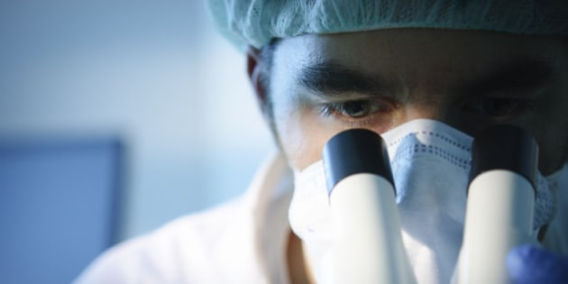 A scientist using a microscope