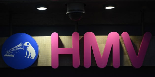 The sign is seen at the front of a HMV shop in central London, January 15, 2013. HMV, the 92-year-old British music retailer seeking protection from creditors, is unlikely to have much of a future beyond a rump of stores and the internet, if other recent retail failures are any guide.   REUTERS/Paul Hackett (BRITAIN - Tags: BUSINESS ENTERTAINMENT)