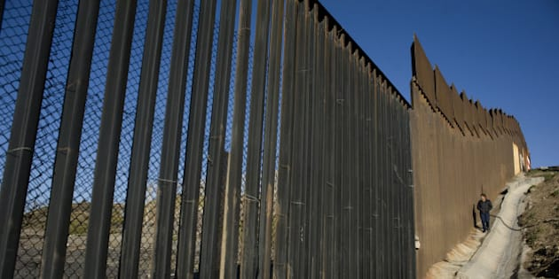 A person walks along a section of the U.S.-Mexico border wall in Tijuana, Mexico, on Thursday, Jan. 26, 2017. U.S. President Donald Trump signed a pair of orders to set in motion the construction of a 'physical wall' across the 1,989 mile length of the southern border and to strengthen immigration enforcement within the U.S. Photographer David Maung/Bloomberg via Getty Images