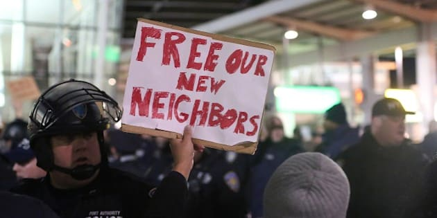 NEW YORK, UNITED STATES - JANUARY 28: Activists stage a rally against President Donald Trump's 90-days ban of entry on 7 Muslim-majority countries in the Fourth terminal of JFK airport in New York, U.S.A on January 28, 2017. (Photo by Mohammed Elshamy/Anadolu Agency/Getty Images)