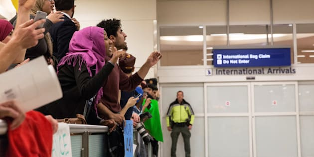 People chant as they gather in protest against the travel ban imposed by U.S. President Donald Trump's executive order, at Dallas/Fort Worth International Airport in Dallas, Texas, U.S. January 28, 2017.  REUTERS/Laura Buckman