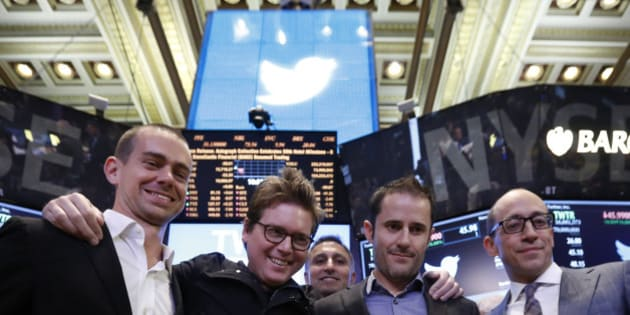 Twitter CEO Dick Costolo (R) celebrates the Twitter IPO with Twitter founders Jack Dorsey (L), Biz Stone (2nd L) and Evan Williams on the floor of the New York Stock Exchange in New York, November 7, 2013.     REUTERS/Brendan McDermid (UNITED STATES  - Tags: BUSINESS SCIENCE TECHNOLOGY)