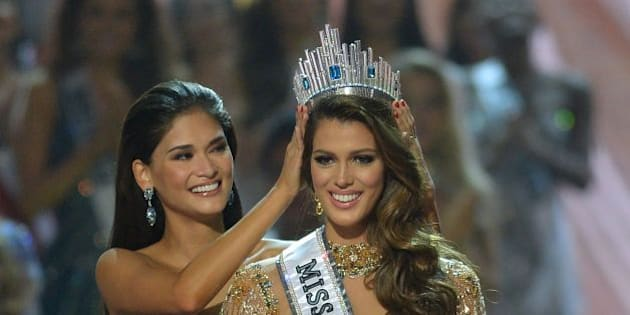 Miss Universe contestant Iris Mittenaere (R) of France is crowned the new 2017 winner by former Miss Universe Pia Wurtzbach of the Philippines (L) during the Miss Universe pageant at the Mall of Asia Arena in Manila on January 30, 2017.