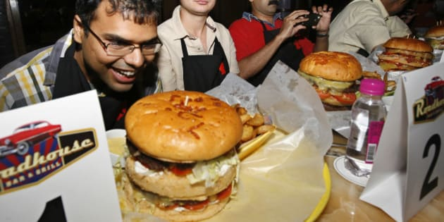 NEW DELHI, INDIA - JULY 04: Burger Demolition competition at Roadhouse Bar and Grill at Doubletree by Hilton Hotel in Mayuir Vihar, New Delhi. (Photo by K Asif/India Today Group/Getty Images)