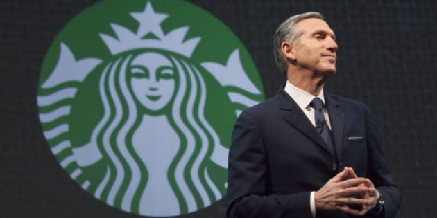 Starbucks Chief Executive Howard Schultz speaks during the company's annual shareholder's meeting in Seattle, Washington March 18, 2015. Starbucks Corp will begin offering delivery in New York City and Seattle later this year, when it also plans to expand mobile order and pay services across the United States.  REUTERS/David Ryder  (UNITED STATES - Tags: BUSINESS)
