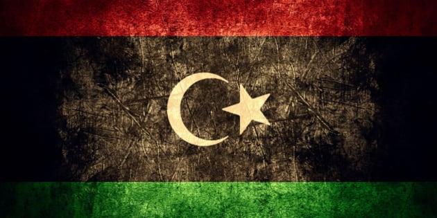 flag of Libya or Libyan banner on rough pattern texture vintage background