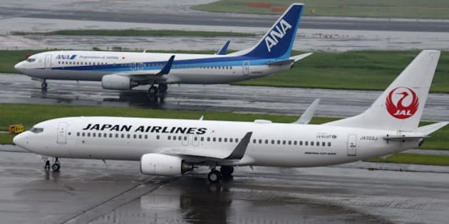 All Nippon Airways (ANA/top) and Japan Airlines (JAL/bottom) aircraft are seen at Haneda Airport in Tokyo on April 28, 2016. 