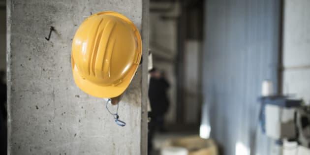 NAFPLION, GREECE - NOVEMBER 04: A protective helmet hangs on a column on a construction site on November 04, 2016 in Nafplion, Greece. (Photo by Florian Gaertner/Photothek via Getty Images)