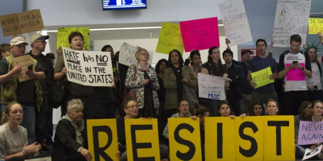 Protesters gather at the International Terminal Arrival Hall of San Francisco International Airport on January 29, 2017 against President Donald Trump's Muslim ban. (Photo by Yichuan Cao/NurPhoto via Getty Images)
