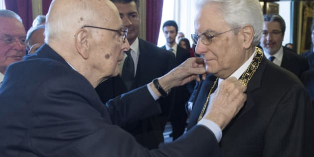 Italy's new President Sergio Mattarella (R) receives a decoration from his predecessor Sergio Napolitano at the Qurinale presidential palace in Rome in this February 3, 2015 handout photo by the Italian Presidency Press Office. REUTERS/Italian Presidency Press Office/Handout via Reuters (ITALY - Tags: POLITICS) 