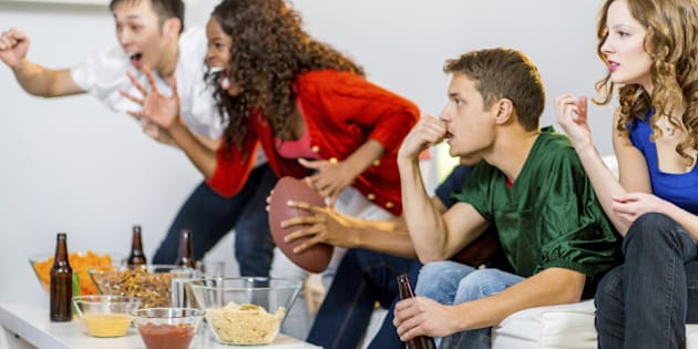 a group of young people watching football game