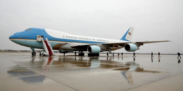 """Journalists board Air Force One at Joint Base Andrews in Maryland U.S. December 6, 2016, on the morning that U.S. President-elect Donald Trump urged the government to cancel purchase of Boeing's new Air Force One plane saying it was """"ridiculous"""" and too expensive.  REUTERS/Kevin Lamarque"""