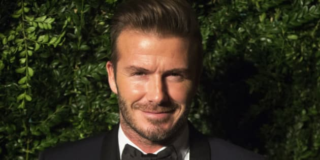 Former British soccer player David Beckham smiles at the Evening Standard Theatre awards in London November 30, 2014. REUTERS/Neil Hall