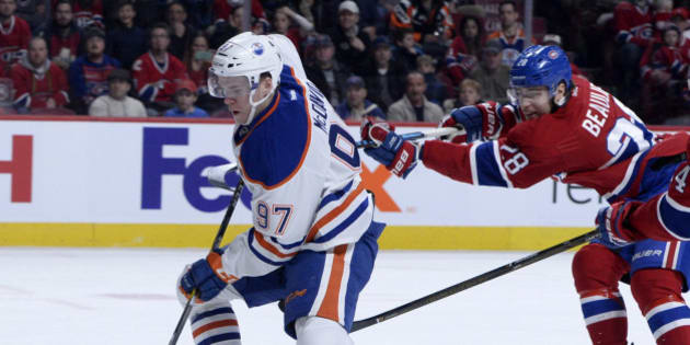 Feb 5, 2017; Montreal, Quebec, CAN; Montreal Canadiens defenseman Nathan Beaulieu (28) skates with the puck in front of Edmonton Oilers forward Connor McDavid (97) during the first period at the Bell Centre. Mandatory Credit: Eric Bolte-USA TODAY Sports