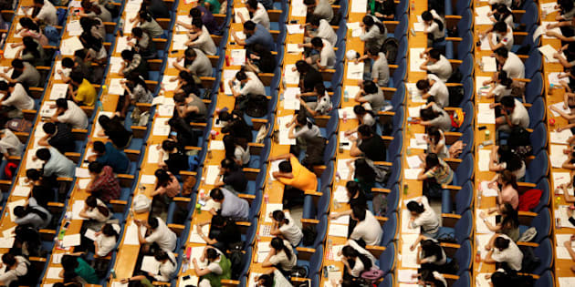 Students attend a lecture for the entrance exam for postgraduate studies at a hall in Jinan, Shandong Province, China, July 18, 2016. Picture taken July 18, 2016. China Daily/via REUTERS ATTENTION EDITORS - THIS IMAGE WAS PROVIDED BY A THIRD PARTY. EDITORIAL USE ONLY. CHINA OUT.