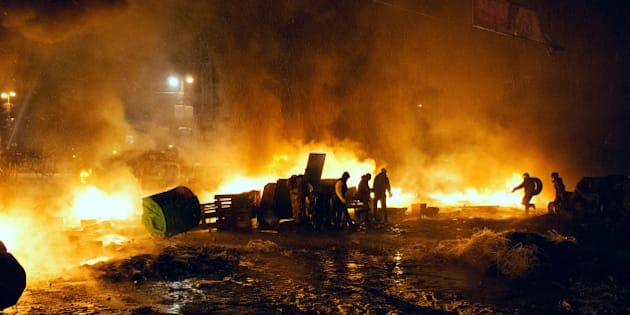 Kyiv, Ukraine - January 22, 2014: Unknown demonstrators fight with police in government district on January 22