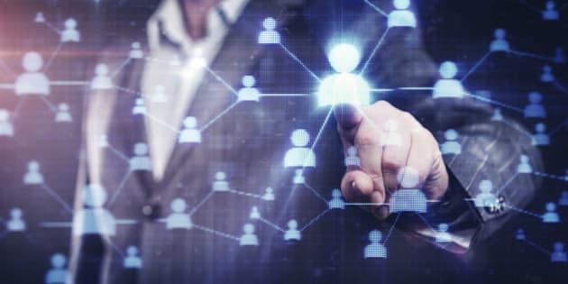 Businessman pressing social network button on modern digital display. Stock photo