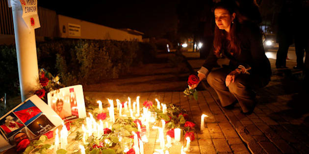 Nathalie Dube, Canada's ambassador to Morocco, lays flowers at a memorial in front of the Embassy of Canada in Rabat February 6, 2017, during a tribute to victims killed at a Quebec City mosque. REUTERS/Youssef Boudlal