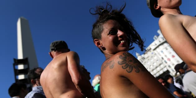 Topless women attend a protest in response to a recent incident on an Argentine resort beach between police and topless sunbathers, in downtown Buenos Aires, Argentina, February 7, 2017. REUTERS/Marcos Brindicci
