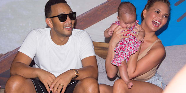 BROOKLYN, NY - AUGUST 28:  Model Chrissy Teigen and musician John Legend with their baby Luna Simone Stephens attend the 2016 Sports Illustrated Summer Of Swim Fan Festival & Concert at Ford Amphitheater at Coney Island Boardwalk on August 28, 2016 in Brooklyn, New York.  (Photo by Michael Stewart/WireImage)
