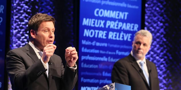 Quebec's Liberal Party leadership candidate Pierre Moreau (L) speaks as Philippe Couillard looks on during their first debate in Montreal, January 13, 2013. REUTERS/Christinne Muschi (CANADA - Tags: POLITICS ELECTIONS)