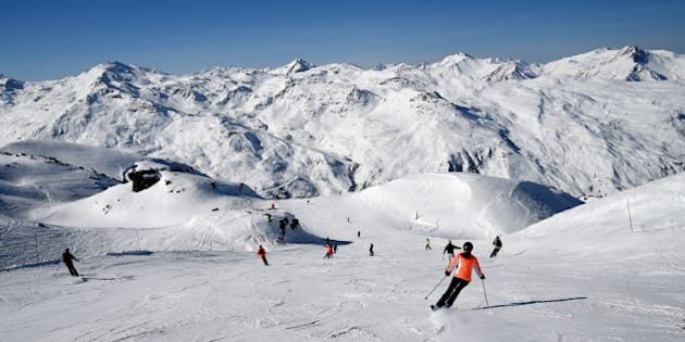 People ski in the French Alps ski resort of Les Menuires on February 16, 2017 during France's school holydays. / AFP / JEAN-PIERRE CLATOT        (Photo credit should read JEAN-PIERRE CLATOT/AFP/Getty Images)