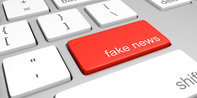 3D render of a red key on a computer keyboard with the label 'fake news'.