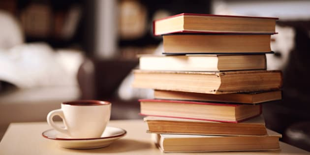 stack of books in home interior