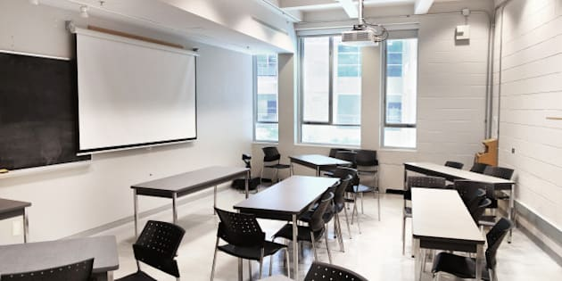 A modern university lecture hall and classroom space set up with movable tables for running a 'seminar' type class.