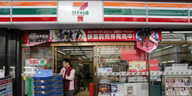 An employee of 7-Eleven works at a convenience store in Tokyo January 8, 2013. Seven & I Holdings Co's quarterly operating profit rose 4.8 percent as higher profits from its 7-Eleven stores helped to offset weaker revenue from other retail formats, leading the Japanese firm to maintain its record annual outlook.   REUTERS/Yuriko Nakao (JAPAN - Tags: BUSINESS EMPLOYMENT)
