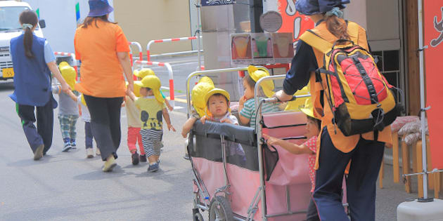 Tokyo Japan - May 22, 2015: Japanese kindergarden kids and teachers walk on street in Asakusa Tokyo Japan.