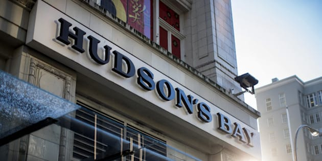 Signage is displayed outside a Hudson's Bay Co. store in downtown Vancouver, British Columbia, Canada, on Thursday, Jan. 12, 2017. Hudsons Bay Co., the Canadian department-store giant that owns Saks Fifth Avenue and Lord & Taylor, suffered its worst stock decline in more than a year after a dismal holiday season weighed on its sales forecast. Photographer: Ben Nelms/Bloomberg via Getty Images