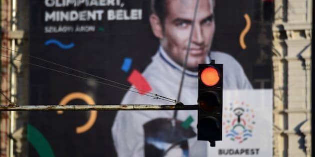 This picture taken on January 17, 2017 in Budapest shows a poster of Hungarian Olympic winner of sabre in Rio de Janeiro 2016 and London 2012, Aron Szilagyi, advertising Budapest's bid to host the 2024 Olympic Games .    Budapest's bid to host the 2024 Olympic Games faces a new referendum challenge after a youth group critical of Prime Minister Viktor Orban said they will begin collecting signatures this week. / AFP / ATTILA KISBENEDEK        (Photo credit should read ATTILA KISBENEDEK/AFP/Getty Images)
