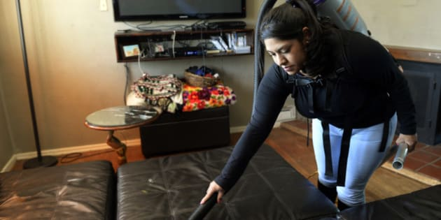 DENVER, CO - APRIL 8:  How to hire a housecleaning service for your home. Yareli Gonzalez of Wendy's Cleaning Service works the vacuum as she cleans a home in  Denver  on Tuesday, April 8, 2014.  (Denver Post Photo by Cyrus McCrimmon)