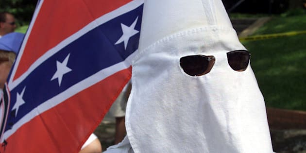 "File photo showing a Ku Klux Klan member during a demonstration in Huntsville, Texas on June 22, 2000. Suspected Ku Klux Klansman Edgar Ray Killen, 79, was arrested without incident for the 1964 murders of three civil rights workers in Mississippi, reopening one of the most notorious civil rights-era crimes, police said January 7, 2005. His arrest marks the first time that anyone has faced state prosecution for the murders of three volunteers, who were abducted and then slain on a remote road outside the town 40 years ago. The volunteers, all in their 20s, died while working to register black voters during the so-called Freedom Summer civil rights campaign in the once-segregated southern state. Their story was dramatized in the 1988 movie ""Mississippi Burning."" REUTERS/Adrees A. Latif/FILE  AAL/GN"