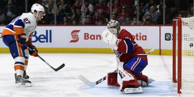 Feb 23, 2017; Montreal, Quebec, CAN; New York Islanders forward Anders Lee (27) scores a goal  against Montreal Canadiens goalie Carey Price (31) during the second period at the Bell Centre. Mandatory Credit: Eric Bolte-USA TODAY Sports