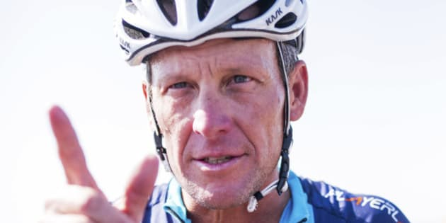 Cyclist Lance Armstrong of the U.S. gestures during a break as he takes part in Geoff Thomas's 'One Day Ahead' charity event during a stage of the 102nd Tour de France cycling race from Muret to Rodez, France, July 16, 2015. Disgraced cyclist Lance Armstrong made a low key return to the Tour de France on Thursday when the American cancer survivor set off on a charity ride that follows the route of this year's race.  REUTERS/Fred Lancelot