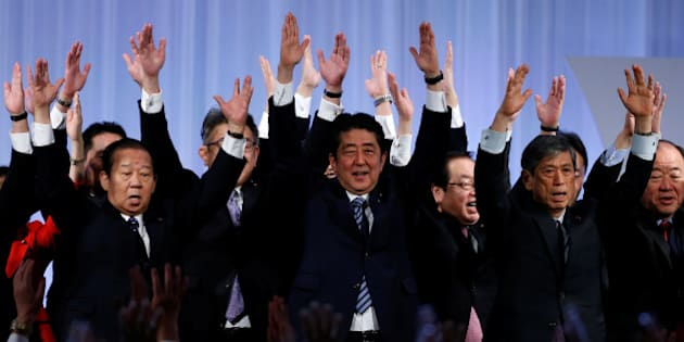"""Japan's Prime Minister Shinzo Abe (C) shouts """"Banzai!"""" (cheers) as he raises his hands with members of the ruling Liberal Democratic Party (LDP) during the annual party convention in Tokyo, Japan, March 5, 2017.  REUTERS/Toru Hanai     TPX IMAGES OF THE DAY"""