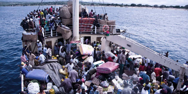 Kigoma, Tanzania - November 23, 2008: Overloaded ship Liemba is leaving the Port of Kigoma on Lake Tanganyika