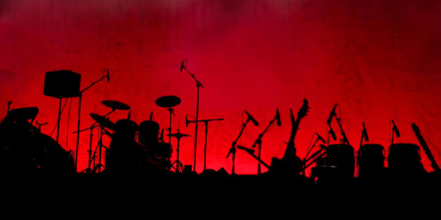 A stage in silhouette before a concert