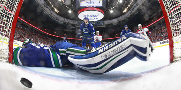VANCOUVER, BC - MARCH 7: Paul Byron #41 of the Montreal Canadiens scores against Ryan Miller #30 of the Vancouver Canucks during their NHL game at Rogers Arena March 7, 2017 in Vancouver, British Columbia, Canada.  (Photo by Jeff Vinnick/NHLI via Getty Images)