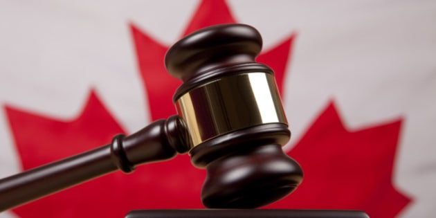 Gavel in front of Canadian flag representing Canadian legal and justice system.